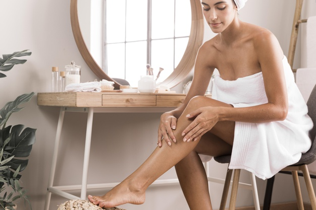 woman-using-cream-her-legs_23-2148752465